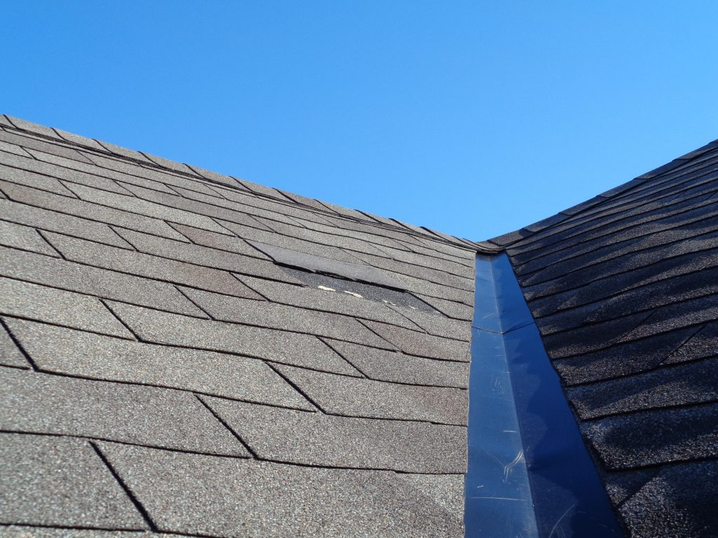 A roof with one missing shingle